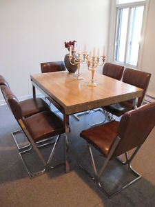 Nice Reader Sheldonu0027s Changing It Up Chez Lui, And Has This Styling U002770s Wood  And Chrome Expanding Dining Table That Seats Ten, Plus Six Brown Naugahyde  U0026 Chrome ...